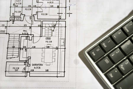 tabulation: Close up photo of architecture plan with calculator Stock Photo