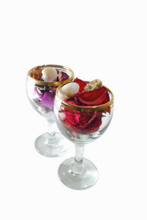 Two isolated  glasses with pressed flowers on a white background