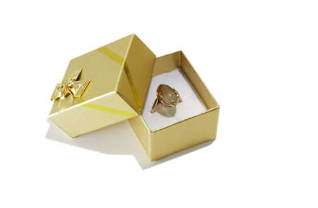 Isolated fancy box with the golden ring on a white background