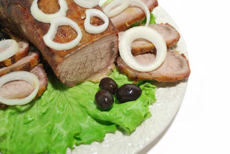 Close up fillet of beef and onion on a white plate