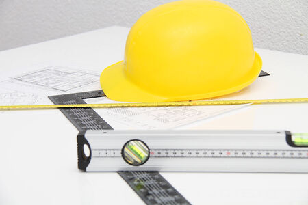Helmet and tools for construction drawings and buildings photo