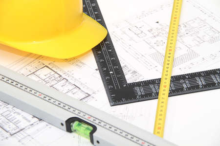 Photo of the Helmet and tools for construction drawings and buildings photo