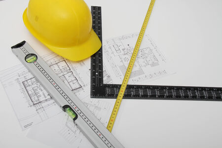 hard cap: Photo of the Helmet and tools for construction drawings and buildings Stock Photo