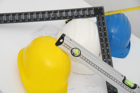 Helmets and tools for construction drawings and buildings photo