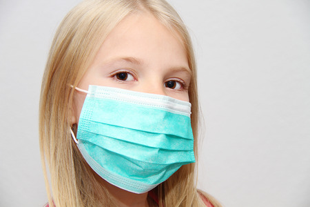 Little girl wearing a protective mask Stockfoto