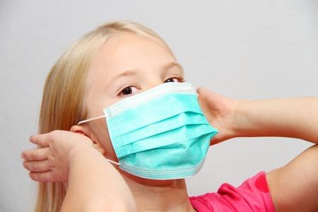 Little girl wearing a protective mask Standard-Bild