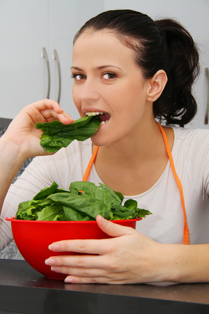 Woman with a spinach in a modern kitchen photo