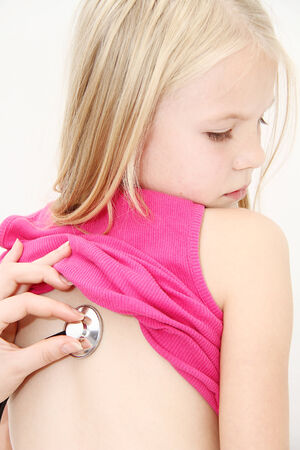 listened: Little girl being listened by a doctor Stock Photo