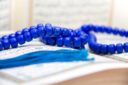 profit celebration: Photo of the Rosary and Qoran