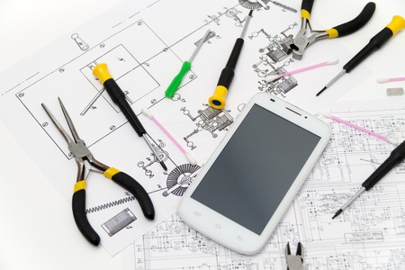 repaired: Photo of the Technical operator and repair smartphone