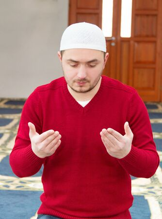 muslim prayer: Photo of the Young muslim man showing Islamic prayer