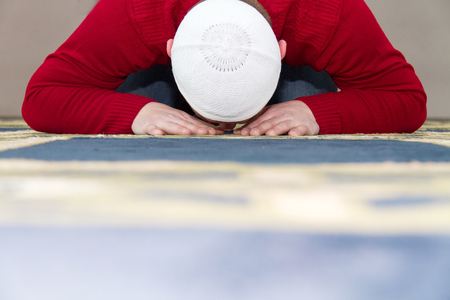 islamic pray: Photo of the Young muslim man showing Islamic prayer