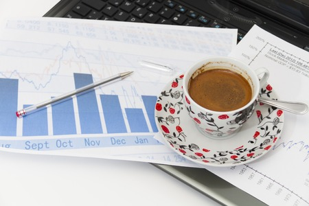 Photo of the Businessman  with coffee and laptop analyzing of the  monitoring profit dynamics in the company photo