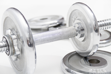 kilos: Photo of the Fitness concept with Grey dumbbells and loose weights