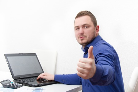 Photo of the Happy young business man work in modern office on computer
