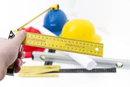 photo tools: Photo of theColorful helmets and tools for construction drawings and buildings