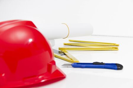Photo of theColorful helmets and tools for construction drawings and buildings photo