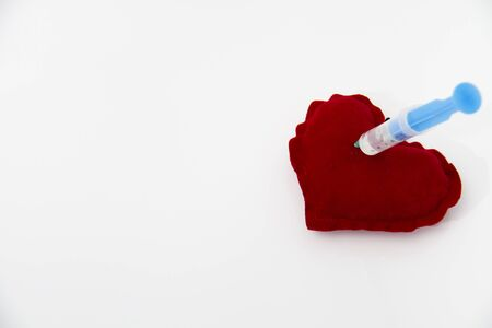 Photo of the Syringe injecting a red heart and health concept, healthy life