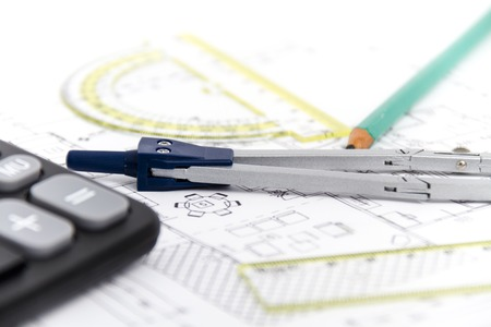 Photo of the Architectural project, pair of compasses, rulers and calculator photo