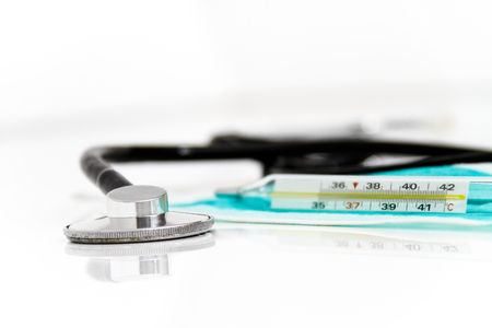 snivel: Photo of the Set for flu treatment, thermometer, nasal sprays, protective surgical mask, stethoscope, syringe...