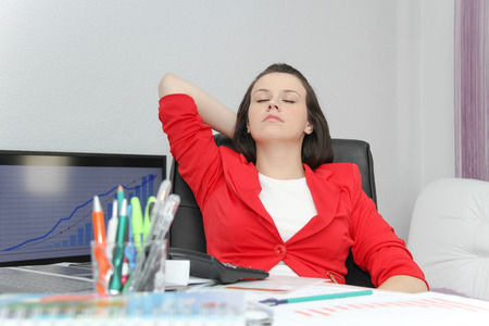 Photo of the Beautiful business woman dreaming while working on computer at her office Stock Photo