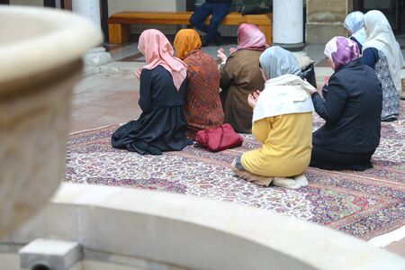 niqab: Photo of the Prayer performing by muslim women Stock Photo