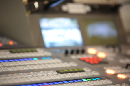 editor: TV editor working with video and audio mixer