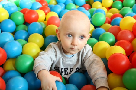 plaything: Photo of the Beautiful baby boy playing at playland Stock Photo