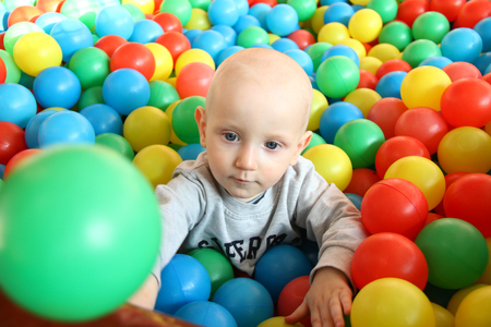 Photo of the Beautiful baby boy playing at playland Stock Photo