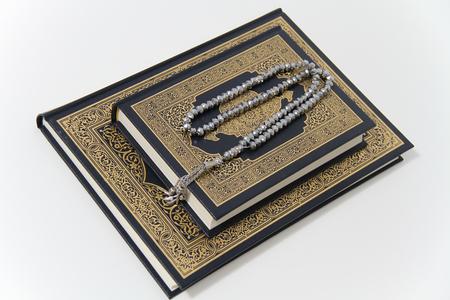 Holy islamic book Koran and rosary