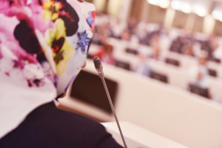 Muslim business woman representing model of economic development and startup business, Audience at the conference hall, Business Conference and Presentation