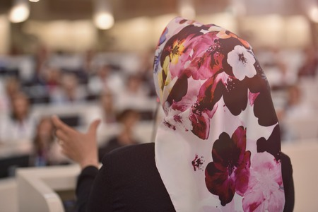 Muslim business woman having presentation during regional business investment conference Stock Photo