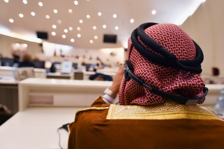 Business Conference and Presentation,Arabic businessman representing model of economic development and startup business, Audience at the conference hall