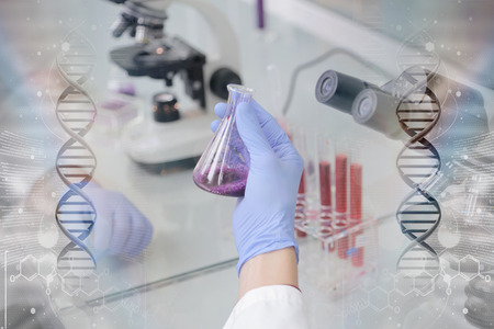 Young male Laboratory scientist working at lab with test tubes and microscope, test or research in clinical laboratory.Science, chemistry, biology, medicine and people concept.