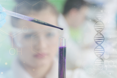 Two Young Female and male Laboratory scientists working at lab with test tubes and microscope, test or research in clinical laboratory.Science, chemistry, biology, medicine and people concept.