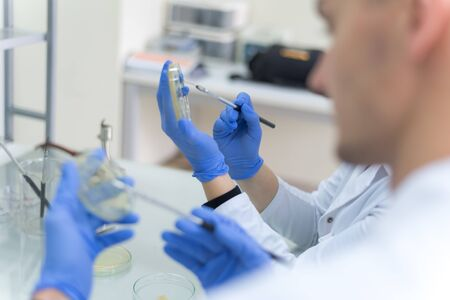 A group of scientists conducts research in a scientific laboratory using advanced technology. COVID-19. COVID Coronavirus