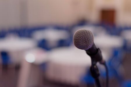Focus on Microphone in conference room or hall, prepairing for business conference. Archivio Fotografico