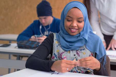 Beautiful female muslim african american architecture student  smiling into camera. Standard-Bild