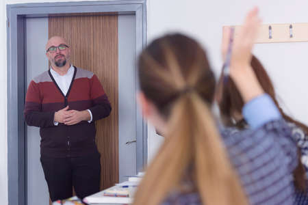 Male professor of architecture explain lesson to multiethnic students and interact with them in the modern classroom.Helping a students during class. Standard-Bild