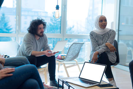 Startup Marketing Idea Presentation. Group of Young multiethnic Coworkers Making Great Business Decisions. Creative Team Discussion Corporate Work Concept inside Modern Office.