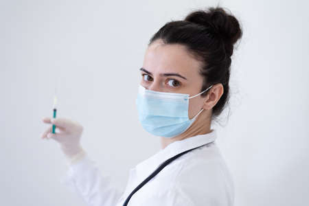 Female Doctor preparing the vaccine