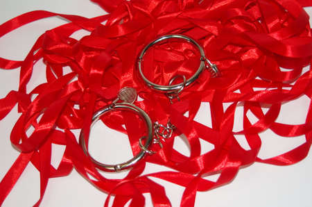 Steel handcuff on red ribbon photo