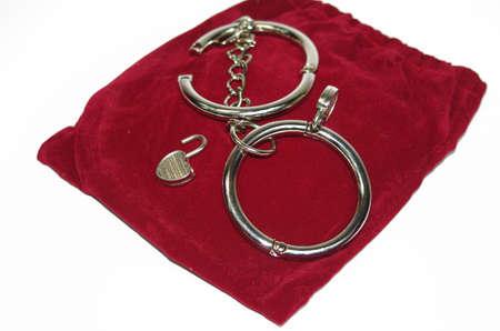Steel handcuff Stock Photo