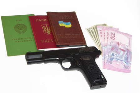 A hand Gun, Passport and Money set on a white background base