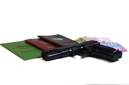 A hand Gun, Passport and Money set on a white background base  photo