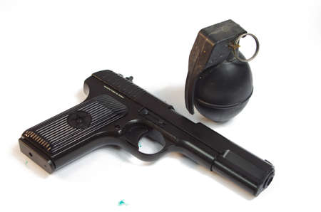 A hand Gun and Grenate set on a white background base  Stock Photo