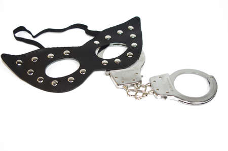 Fetish mask and a handcuff