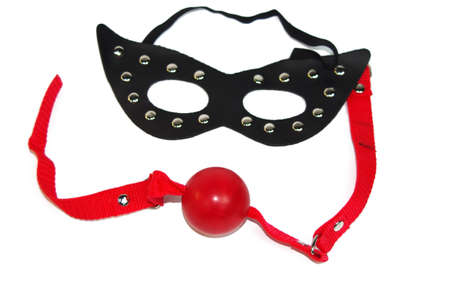 Fetish mask and a red ballgag Stock Photo