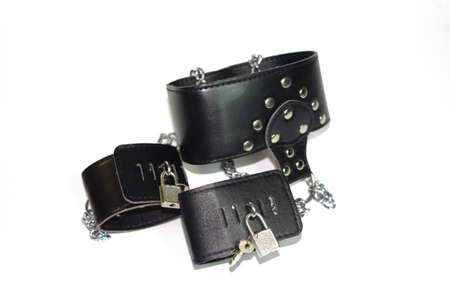 Black leather collar with the wrist on w Stock Photo