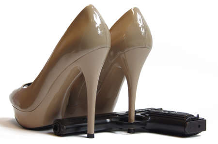 High heels shoes and gun Stock Photo